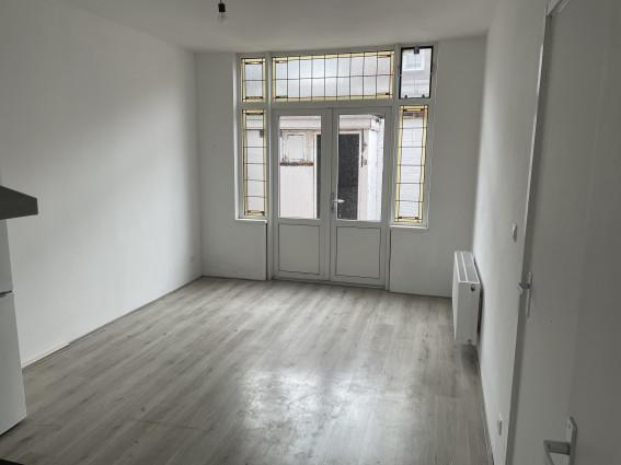 Beneden appartement met kleine stadstuin